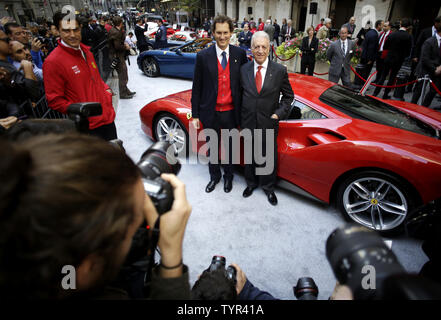 Fiat Chrysler chairman John Elkann and Piero Ferrari, son of founder Enzo Ferrari stand with a Ferrari outside of the NYSE after the opening bell on the first day of public trading of Ferrari at the New York Stock Exchange on Wall Street in New York City on October 21, 2015. The company's stock priced its initial public offering at $52 a share after the market close on Tuesday, with sources saying the demand for shares was 'well oversubscribed.' The price was at the top of the previously indicated range of $48 to $52 per share. Ferrari RACE shares were trading at $58.18 up almost 10 percent We - Stock Photo