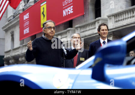Fiat Chrysler CEO Sergio Marchionne, Ferrari CEO Amedeo Felisa and Fiat Chrysler chairman John Elkann speak to the media outside of the NYSE after the opening bell on the first day of public trading of Ferrari at the New York Stock Exchange on Wall Street in New York City on October 21, 2015. The company's stock priced its initial public offering at $52 a share after the market close on Tuesday, with sources saying the demand for shares was 'well oversubscribed.' The price was at the top of the previously indicated range of $48 to $52 per share. Ferrari RACE shares were trading at $58.18 up al - Stock Photo