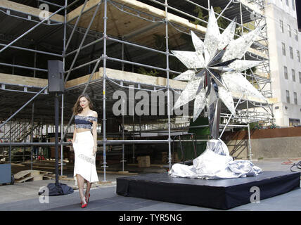 Super Model Miranda Kerr stands with the Swarovski Star before it is raised to the top of the world-famous Rockefeller Center Christmas tree on November 16, 2015 in New York City. 2015 marks the 12th year the Swarovski Star will adorn the Rockefeller Center Christmas tree. The Star is comprised of 25,000 crystals, with one million facets, and measures 9 and 1/2 feet in diameter and 1 1/2 feet deep. The Star weighs 550 pounds, including 300 pounds of crystal panels, and is composed of six outer rays and six smaller inner rays.       Photo by John Angelillo/UPI - Stock Photo