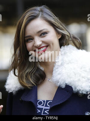 Super Model Miranda Kerr stands near the Swarovski Star before it is raised to the top of the world-famous Rockefeller Center Christmas tree on November 16, 2015 in New York City. 2015 marks the 12th year the Swarovski Star will adorn the Rockefeller Center Christmas tree. The Star is comprised of 25,000 crystals, with one million facets, and measures 9 and 1/2 feet in diameter and 1 1/2 feet deep. The Star weighs 550 pounds, including 300 pounds of crystal panels, and is composed of six outer rays and six smaller inner rays.       Photo by John Angelillo/UPI - Stock Photo
