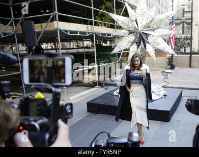 Super Model Miranda Kerr is photographed while standing near the Swarovski Star before it is raised to the top of the world-famous Rockefeller Center Christmas tree on November 16, 2015 in New York City. 2015 marks the 12th year the Swarovski Star will adorn the Rockefeller Center Christmas tree. The Star is comprised of 25,000 crystals, with one million facets, and measures 9 and 1/2 feet in diameter and 1 1/2 feet deep. The Star weighs 550 pounds, including 300 pounds of crystal panels, and is composed of six outer rays and six smaller inner rays.       Photo by John Angelillo/UPI - Stock Photo