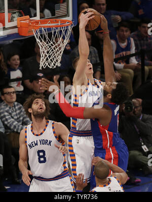 New York Knicks Robin Lopez watches Kristaps Porzingis block a shot from Detroit Pistons Andre Drummond in the first half at Madison Square Garden in New York City on December 29, 2015.    Photo by John Angelillo/UPI - Stock Photo