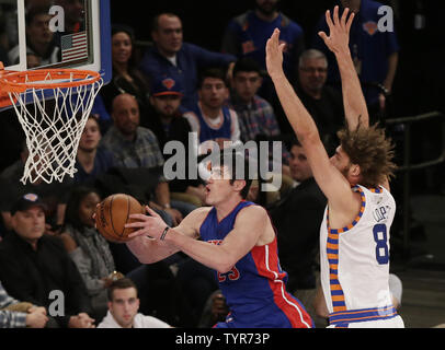 New York Knicks Robin Lopez defends Detroit Pistons Ersan Ilyasova who drives to the basket in the first quarter at Madison Square Garden in New York City on December 29, 2015.   Photo by John Angelillo/UPI - Stock Photo