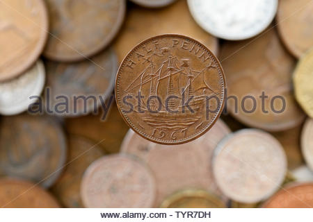 Close up image of a 1967 One Penny piece with other pre-decimal