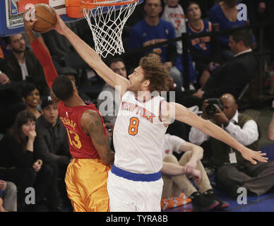 New York Knicks Robin Lopez blocks a shot from Indiana Pacers Paul George in the first half at Madison Square Garden in New York City on April 3, 2016.     Photo by John Angelillo/UPI - Stock Photo