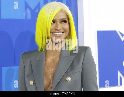 Cassie arrives on the red carpet with a view of the Empire State Building at the 2016 MTV Video Music Awards at Madison Square Garden in New York City on August 28, 2016. Performers at the 2016 MTV VMA's include Rihanna, Britney Spears, Ariana Grande and Nicki Minaj.       Photo by John Angelillo/UPI - Stock Photo