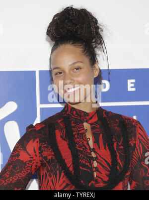 Alicia Keys arrives on the red carpet with a view of the Empire State Building at the 2016 MTV Video Music Awards at Madison Square Garden in New York City on August 28, 2016. Performers at the 2016 MTV VMA's include Rihanna, Britney Spears, Ariana Grande and Nicki Minaj.       Photo by John Angelillo/UPI - Stock Photo