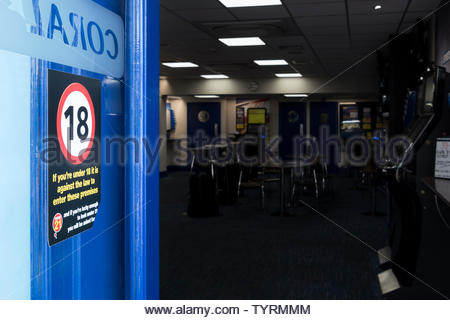 Straight on image looking into an open Coral betting shop in Ringwood, Hampshire, England, UK - Stock Photo