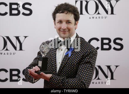 Bradley King, winner of the award for Best Lighting Design of a Musical for ?Natasha, Pierre & The Great Comet of 1812,? arrives in the press room with a Tony Award at the 71st Annual Tony Awards at Radio City Music Hall on June 11, 2017 in New York City.    Photo by John Angelillo/UPI - Stock Photo
