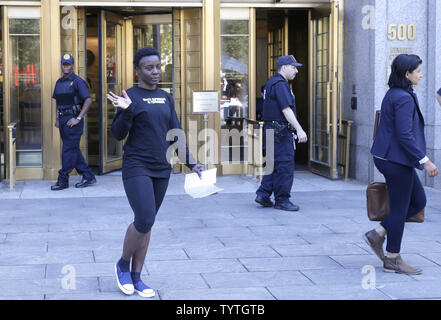 Statue Of Liberty climber and Rise and Resist protester Therese Okoumou exits Court in New York City on July 5, 2018 in New York City. The woman who partially climbed up the Statue of Liberty on July 4th Independence Day and prompted authorities to evacuate Liberty Island was released without bail, and if convicted would face up to six months behind bars.    Photo by John Angelillo/UPI - Stock Photo