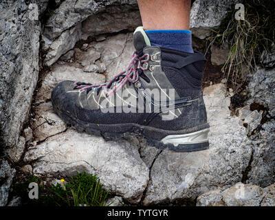 Trekking boot on a rock - Stock Photo