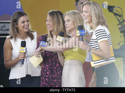 GMA co hosts Paula Faris, Ginger Zee, Amy Robach and Lara Spencer speak on stage before Camila Cabello performs on the Good Morning America Show at the Rumsey Playfield/SummerStage in Central Park in New York City on July 20, 2018.      Photo by John Angelillo/UPI - Stock Photo