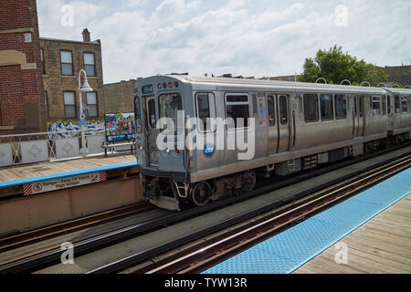 view of the blue line L train station at with train Damen Chicago IL USA - Stock Photo
