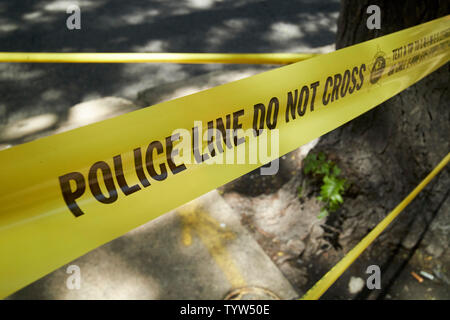 Police Line do not cross yellow incident tape chicago police department Chicago IL USA - Stock Photo