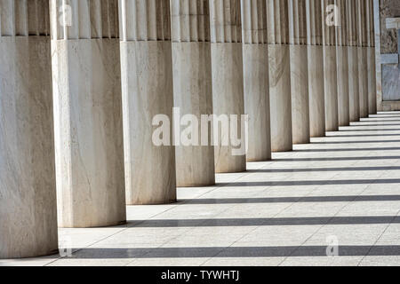 Row of Marble columns in Athens, Greece - Stock Photo