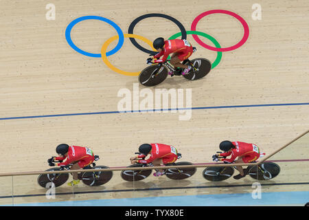 Cyclists from the People's Republic of China team compete in the Men's Team Pursuit Qualifying round at the Rio Olympic Velodrome during the 2016 Summer Olympics in Rio de Janeiro, Brazil, on August 11, 2016. China qualified for the next round with a time of 4:05.152.   Photo by Richard Ellis/UPI.. - Stock Photo
