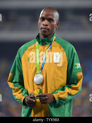 Luvo Manyonga (RSA) reacts after his MenÕs Long Jump silver in the Olympic Stadium at the 2016 Rio Summer Olympics in Rio de Janeiro, Brazil, on August 13, 2016. Photo by Kevin Dietsch/UPI - Stock Photo