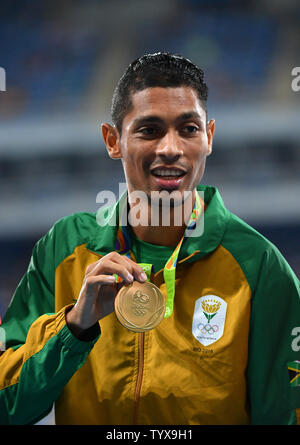 Gold medalist Wayde Van Niekerk (RSA) celebrates during the Men's 400m victory ceremony in the Olympic Stadium at the 2016 Rio Summer Olympics in Rio de Janeiro, Brazil, on August 15, 2016. Photo by Kevin Dietsch/UPI - Stock Photo