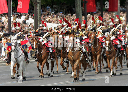 France's Republican Guards parade on the Champs-Elysees during the Bastille Day military parade in Paris, Juillet 14, 2007. French President Nicolas Sarkozy presided the National Day ceremonies for the first time with military units from across the European Union taking part. (UPI Photo/Eco Clement) - Stock Photo