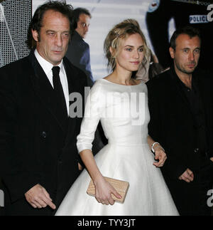 Actor Vincent Lindon (L), actress Diane Kruger (C) and director Fred Cavaye arrive at the French premiere of the film 'Pour Elle (Anything for Her)' in Paris on November 30, 2008.   (UPI Photo/David Silpa) - Stock Photo