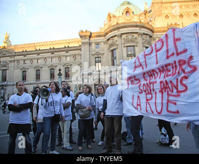 Demonstrators protest unfair working conditions in front of the Apple Store near Place de l'Opera during the launch of the new iPhone 5 that was released today in Paris on September 21, 2012.   UPI/David Silpa - Stock Photo