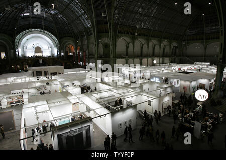Visitors scroll through the International Contemporary Art Fair (FIAC) at the Grand Palais in Paris on opening day, October 17, 2012. UPI/Eco Clement - Stock Photo