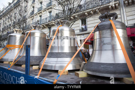 Some of the nine new bronze bells to be installed in the towers of Notre Dame are seen en route to the cathedral in Paris on January 31, 2013.   The bells, named after saints and weighing a total of 23 tons altogether, will be on display at the cathedral through February 25 and will be rung for the first time on Palm Sunday, March 24.  The new bells took 18 months to build and are expected to last 200 to 300 years.   UPI/ David Silpa - Stock Photo