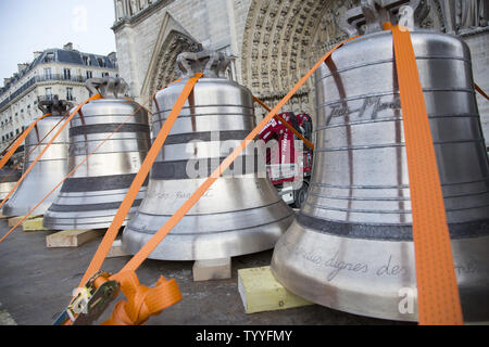 Some of the nine new bronze bells to be installed in the towers of Notre Dame are displayed in front of the cathedral in Paris on January 31, 2013.  The bells, named after saints and weighing a total of 23 tons altogether, will be on display at the cathedral through February 25 and will be rung for the first time on Palm Sunday, March 24.  The new bells took 18 months to build and are expected to last 200 to 300 years.   UPI/ David Silpa - Stock Photo