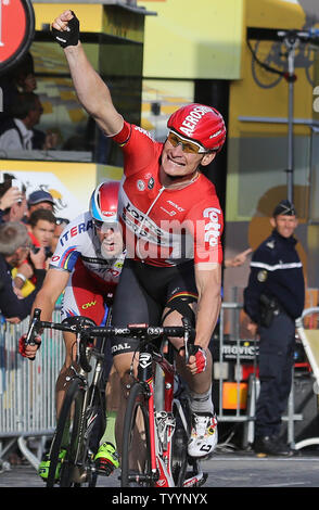 Andre Greipel (L) of Germany crosses the finish line to win the final stage of the Tour de France in Paris on July 26, 2015.  Chris Froome of Great Britain claimed his second Tour de France victory, becoming the first Briton to do so.   Photo by David Silpa/UPI - Stock Photo