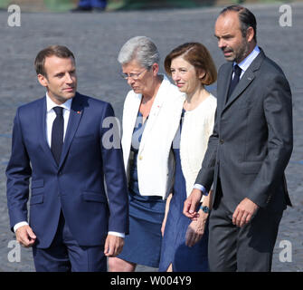(From L to R) French President Emmanuel Macron, French Secretary of State to the Minister of the Armed Forces Genevieve Darrieussecq, French Armed Forces Minister Florence Parly and French Prime Minister Edouard Philippe arrive before the start of the annual Bastille Day military parade along Avenue des Champs-Elysees in Paris on July 14, 2018.   Photo by David Silpa/UPI - Stock Photo