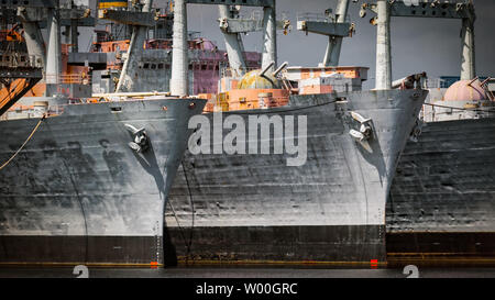 Decommissioned Navy ships, sometimes called the 'mothball fleet', in Philadelphia, PA. - Stock Photo