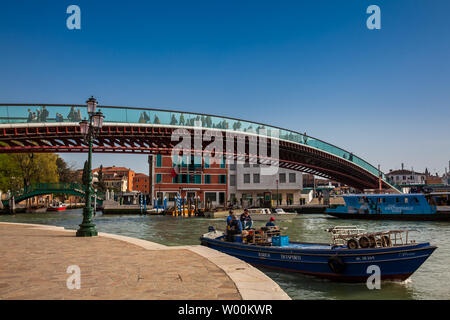 VENICE, ITALY - APRIL, 2018: Constitution Bridge over the Grand Canal in Venice in a beautiful early spring day - Stock Photo