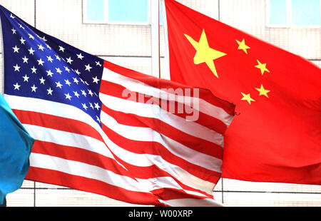 Both the American and Chinese national flags fly outside the hotel where U.S. Vice President Joe Biden will stay next week in Beijing on August 12, 2011.  Biden will visit China's capital in the wake of the country's pointed criticism of Washington's failure to solve its debt crisis.    UPI/Stephen Shaver