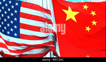 Both American and Chinese national flags fly next to each other outside an international hotel in Beijing on July 7, 2013.  Even after months of tensions over alleged cyberattacks and continual trade disputes, the leaders of China and the United States have struck positive tones recently as both agreed on forging a 'new model' for their relations going forward.        UPI/Stephen Shaver