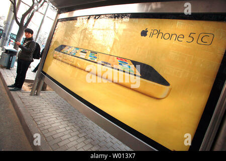 Apple's new iPhone 5C is promoted on the streets of Beijing on December 8, 2013.  China, the world's biggest smartphone market, had 1.2 billion mobile phone users as of the end of October.  Apple and China Mobile have reportedly inked a much-anticipated deal that should make buying an iPhone easier for hundreds of millions of Chinese.   UPI/Stephen Shaver - Stock Photo