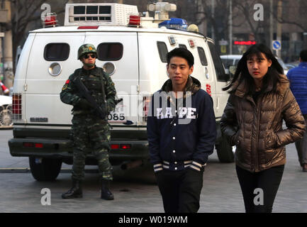 Heavily armed paramilitary urban commando units, called the Snow Leopards, continue to stand guard outside an international shopping and cultural center before New Year's eve in Beijing on December 31, 2015.  Security has been tightened around an area popular with foreigners after the U.S, embassy issued warnings that foreigners should be on guard for possible threats against them.  The government initiated a yellow alert for the area during the Christmas holiday season.   Photo by Stephen Shaver/UPI - Stock Photo