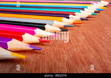 A neatly arranged colored pencil on the table. - Stock Photo