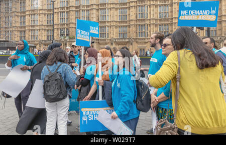 London / UK - June 26th 2019 - Young activists holding climate change signs outside Parliament in Westminster as part of a climate change event - Stock Photo
