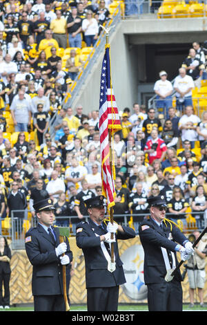 The Shanksville Volunteer Fire Department color guard presents the colors during the Nation Anthem before the start of the Pittsburgh Steelers and Seattle Seahawks football game at Heinz Field in Pittsburgh, Pennsylvania on September, 18 2011. The Shanksville Fire Department while the first responders for the crash od Flight 93 10 years.  UPI/Archie Carpenter - Stock Photo