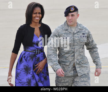 First Lady Michelle Obama walks with Senior Airman Domenic Mash (R) on the tarmac at the base for the 911th Airlift Wing of the Air Force Reserve Command and the 171st Air Refueling Wing near Pittsburgh on April 17, 2012.    UPI/Archie Carpenter - Stock Photo