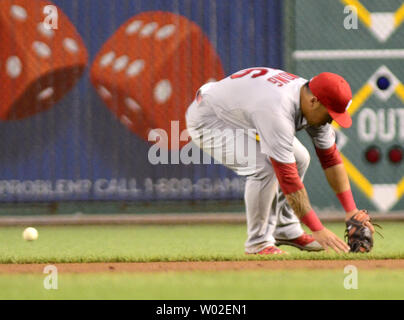 St. Louis Cardinals second baseman Kolten Wong (16) allows the ball to get pass him giving Pittsburgh Pirates third baseman Pedro Alvarez (24) a single in the fourth inning against the Pittsburgh Pirates at PNC Park in Pittsburgh, on August 25, 2014.  UPI/Archie Carpenter - Stock Photo