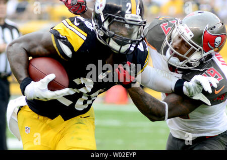 Tampa Bay Buccaneers cornerback Leonard Johnson (29) wraps up Pittsburgh Steelers running back Le'Veon Bell (26) during the second quarter at Heinz Field in Pittsburgh on September 28, 2014.  UPI/Archie Carpenter - Stock Photo