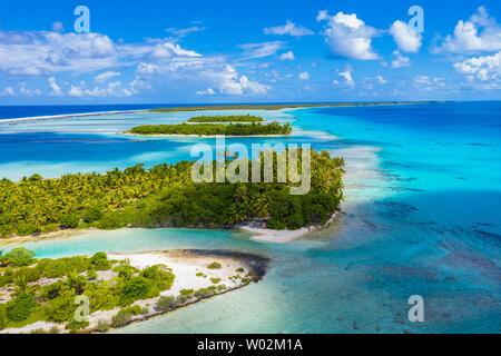 Drone aerial video of Rangiroa atoll island motu and coral reef in French Polynesia, Tahiti. Amazing nature landscape with blue lagoon and Pacific Ocean. Tropical travel paradise in Tuamotus Islands. - Stock Photo