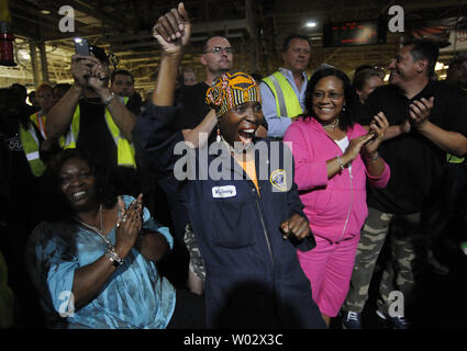 United Auto Workers celebrate the production launch of the 2010 Ford Taurus at Ford Motor Company's plant in Chicago on August 4, 2009. Boosted by the U.S. government 'Cash for Clunkers' program, Ford Motor Co reported Monday a 2.3 percent rise U.S. auto sales for the month of July, its first year-over-year monthly sales increase since November 2007.     UPI/David Banks - Stock Photo