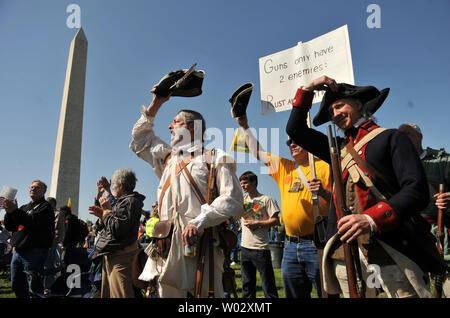 People dressed as Minutemen from the Revolutionary War attend a second amendment rally on the grounds of the Washington Monument, in Washington on April 19, 2010. Pro-gun rallies where held around the country today, also known as Patriots' Day, the anniversary of the American Revolutionary War battles of Lexington and Concord and the Oklahoma City bombing.    UPI/Kevin Dietsch - Stock Photo