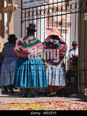 Cholitas at the Basílica de Nuestra Señora church in Copacabana, Bolivia - Stock Photo