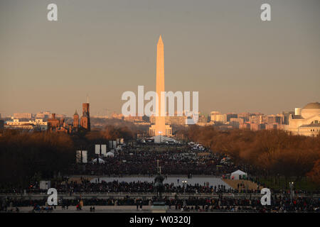 Spectators gather in the early morning light waiting for President Barack Obama to be sworn-in for a second term as the President of the United States by Supreme Court Chief Justice John Roberts during his public inauguration ceremony at the U.S. Capitol Building in Washington, D.C. on January 21, 2013.       UPI/Pat Benic - Stock Photo