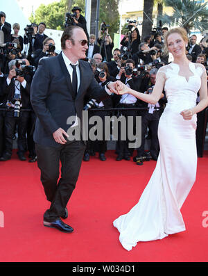 Quentin Tarantino (L) and Uma Thurman dance on the closing ceremony red carpet before the screening of the film 'Fistful of Dollars' during the 67th annual Cannes International Film Festival in Cannes, France on May 24, 2014.  UPI/David Silpa - Stock Photo
