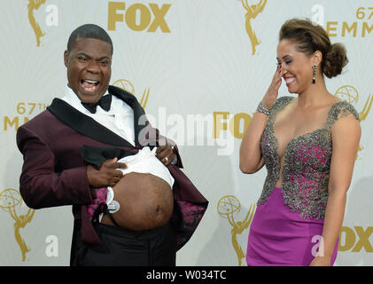 Actor Tracy Morgan (L) and wife Megan Wollover  appear in the photo room at the 67th Primetime Emmy Awards in the Microsoft Theater in Los Angeles on September 20, 2015. Morgan was a surprise presenter, returning fifteen months after an auto accident left him in a coma with numerous broken bones. Photo by Jim Ruymen/UPI - Stock Photo