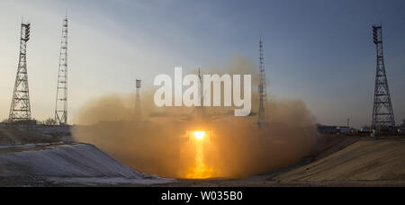 The Soyuz TMA-19M rocket is launched with Expedition 46 Soyuz Commander Yuri Malenchenko of the Russian Federal Space Agency (Roscosmos), Flight Engineer Tim Kopra of NASA, and Flight Engineer Tim Peake of ESA (European Space Agency), Tuesday, Dec. 15, 2015 at the Baikonur Cosmodrome in Kazakhstan.  Malenchenko, Kopra, and Peake will spend the next six-months living and working aboard the International Space Station. NASA photo by Joel Kowsky/UPI - Stock Photo
